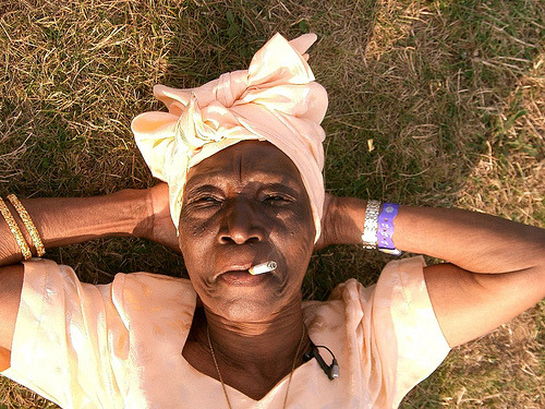 afro-politaine:  dynamicafrica:  RIP to legendary Tanzanian Taarab singer Fatma binti Baraka, popularly known as Bi Kidude, who passed away on April 17th, 2013, at her home on the island of Zanzibar. She is believed to have surpassed 100 years of age.  As a child, she was singled out for her fine voice and, in the 1920s, sang locally with popular cultural troupes, combining an understanding of music with an equally important initiation into traditional medicine.  At age 13, after a forced marriage she fled Zanzibar to mainland Tanzania. Bi Kidude toured mainland East Africa with a taarab ensemble, visiting the major coastal towns and inland as far west as Lake Victoria and Tanganyika.  She walked the length and the breadth of the country barefoot in the early 1930s fleeing another unhappy marriage. In the 1930s she ended up in Dar es Salaam where she sang with Egyptian Taarab group for many years. In the 1940s she returned to Zanzibar where she acquired a small mud hut to be her home.  She is known for her role in the Unyago movement which prepares young Swahili women for their transition through puberty. She is one of the experts of this ancient ritual, performed only to teenage girls, which uses traditional rhythms to teach women to pleasure their husbands, while lecturing against the dangers of sexual abuse and oppression. (source)