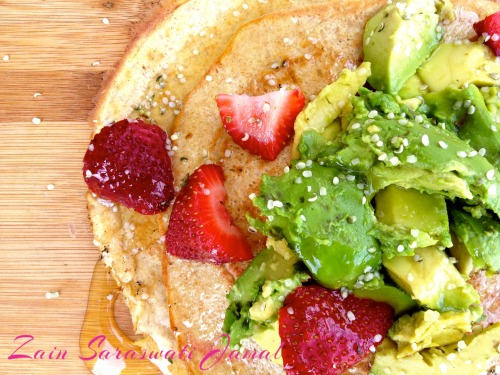 Zain's Strawberry Avocado & Hemp Vegan Pancakes Ready to take your healthy pancakes to another level? These pancakes are my new obsession. I have been smitten with them since I woke up one sleepy morning and couldn't resist the ripe, pregnant avocado staring back at me begging to be mashed all over my pancakes. This recipe is perfect for a spring/summer healthy breakfast or post-workout meal. Ingredients: 56g (1/2 Cup) Oats 1 Scoop SUNWARRIOR Vanilla OR Vegan Protein Powder Of Your Choice (*Non-Vegan's may sub for 5 Egg Whites) 1 Tsp Baking Powder 7-10 Drops Vanilla Creme Stevia 3/4 Cup Unsweetened Almond Milk 1/4 Banana 2 Tbsp Egg Replacer OR 1 Flax Egg – (1/2 Tbsp Ground Flax + 1.5 Tbsp Water, set aside for 3-5 minutes) Toppings: 1oz Avocado 1 Tsp Hemp Seeds 1/2 Cup Strawberries 1 Tbsp Maple Syrup Directions: 1. Combine ground flax in water an set aside 2. Mix dry ingredients together until combined 3. Add all wet ingredients including 'flax egg' OR *egg whites to the dry ingredients (add a little water if the batter is too thick to obtain the consistency you desire) 4. Heat non-stick skillet and pour 1/2 pancake batter onto the grill.  Heat on low heat for two to three minutes or until edges are slightly browned then flip.  Repeat with the remaining half of the batter. **You may also use a dehydrator for this recipe to keep the nutrients in the raw protein bioavailable and raw. 5. Once pancakes are cooked and plated, top with avocado chunks, sliced strawberries, hemp seeds and maple syrup