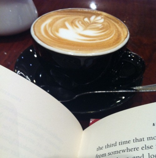 amandaonwriting:  Cappuccino and a book. Heaven.