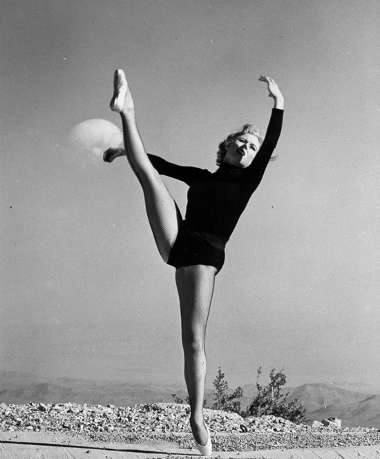 "theniftyfifties:  An ""atomic pin-up girl"" dances in front of a mushroom cloud at Upshot-Knothole Dixie, Nevada, 6th April 1953.  … moments before she and the cameraman are vaporized."