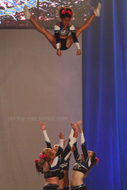you-only-spin-once:  elite-and-all-star-cheerleading:  on-the-mat:  California Allstars  I love the fact the flyer looks so chill up there.  omg this is my friend lyauan<3 she is literally the cutest thing ever and she's a great flyer!!! :)