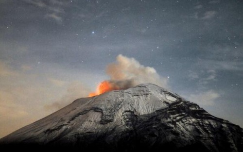 "thinkmexican:  El Popocatépetl Continues to Emit Molten Rock and Ash  A cloud of ash and molten rock spews out of Popocatépetl volcano, about 35 miles from Mexico City, on May 20.  Mexican authorities raised the alert level to ""Yellow Phase Three,"" the fifth of a seven-stage warning system. More than 20 million people from the states of Puebla, Tlaxcala, Morelos, State of Mexico and DF would be affected if ""El Popo"" erupted.  The word Popocatépetl means Smoking Mountain in Nahuatl.  Credit: Arturo Andrade for AFP and Getty."