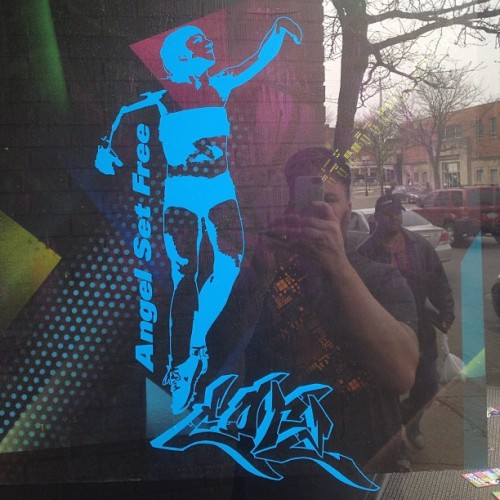 Window stencil of Coco Loupe in the #shortnorth #columbuspublicart #coreroc #core #galleryhop #asf #angelsetfree #socolumbus #asseenincolumbus #reflection #graff #graffiti #streetart #stencilart