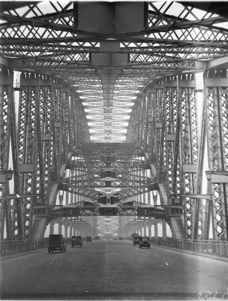 Some of the first vehicles across the completed Sydney Harbour Bridge on the 20th of March, 1932.  Source