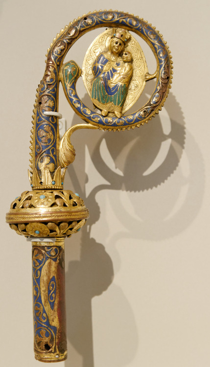 A medieval crosier from Limoges, France, of champleve enamel on copper, with a motif of the Virgin and Child; on display at the Victoria & Albert Museum, London, England; c.1250