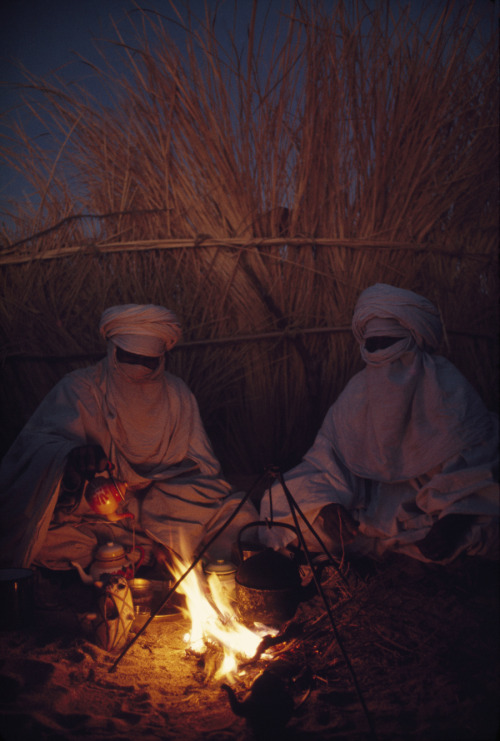 natgeofound: Tuareg goatherds drink tea in their desert shelter at Hassi Izernene, August 1973.Photograph by Thomas J. Abercrombie, National Geographic