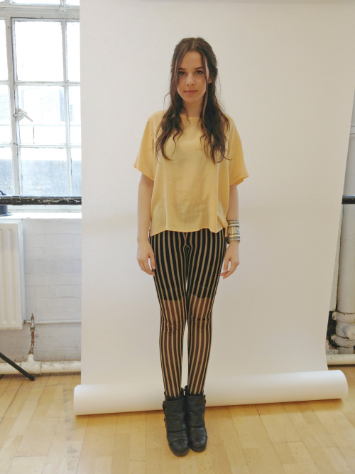 VITTORIA Wears stripped trousers by Forever 21, vintage blouse from Amsterdam, silver bracelet from Brick Lane Market, boots by Kurt Geiger.