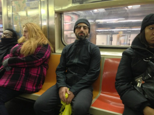 thisistheverge:  Sergey Brin rides the NYC subway like a Google boss Sergey Brin probably doesn't ride the New York City subway that often, but when he does, he does it in style. The Google co-founder was recently spotted on the downtown 3 train, dressed in full ninja regalia and sporting his company's Project Glass augmented reality eyewear. Brooklyn resident and AR enthusiast Noah Zerkin captured the moment late Sunday night, and apparently had a brief conversation with Brin, as well.