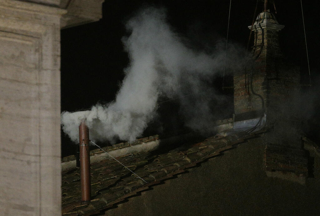 White smoke rises from the chimney above the Sistine Chapel in the Vatican, indicating a new pope has been elected. REUTERS/Max Rossi