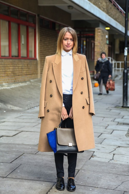 topshop:  A long camel coat is pure elegance, especially combined with a white blouse and black suit pants.