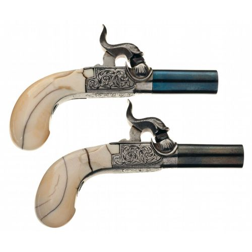 Pair of ivory handled folding trigger percussion muff pistols, early to mid 19th century.