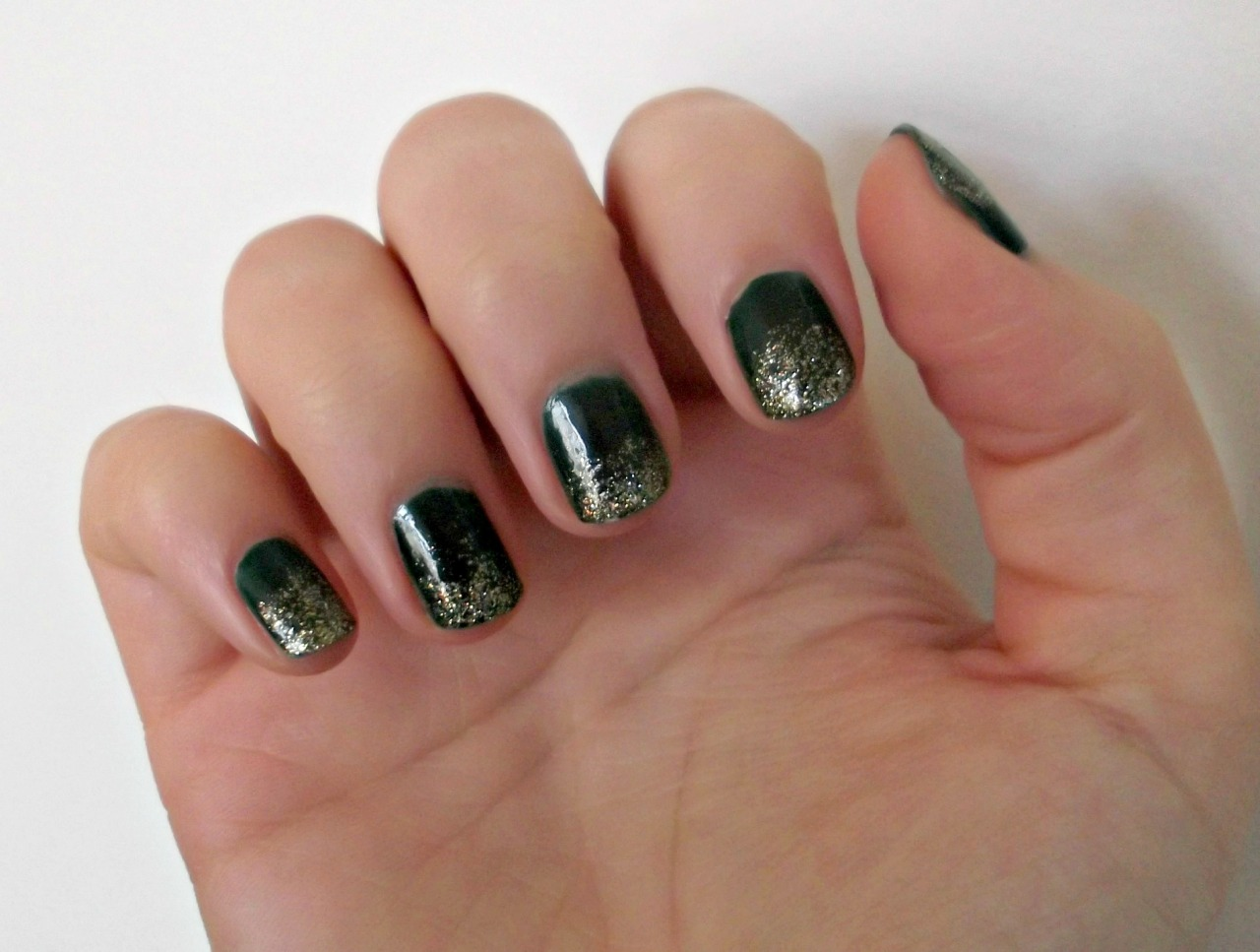 Happy 2013! I decided try a glitter gradient on Christmas day and my left hand turned out pretty well, but my right… not so much. So here, have a picture of my left hand. I used Butter London British Racing Green and West End Wonderland.