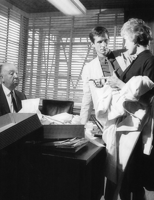 Anthony Perkins and Janet Leigh with director Alfred Hitchcock at Universal Studios, 1959. Photographed by Sid Avery.