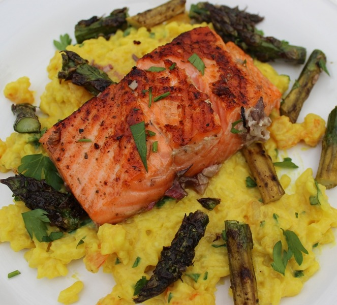 Grilled salmon and marinated asparagus on shrimp/saffron risotto.