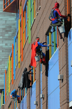 svdp:  These guys are window washers at the children's hospital in Memphis. After being asked several times by the children if they were spiderman or superman, the workers decided to buy the costumes and actually show up as the superheros.  Full story HERE