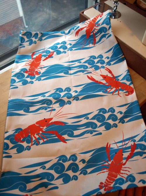 New fabric in, and crayfish/crustacean tea towels in the works! I tweaked the water pattern since the last preview so it had more color to it than just line… we've been fantasizing about recovering one of our chairs in this print!