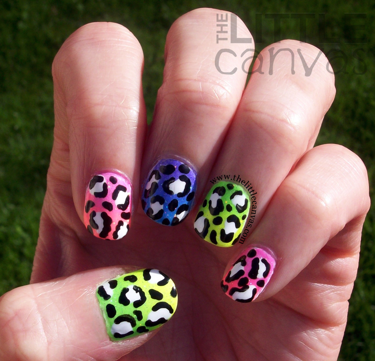 thelittlecanvas:  Neon polishes never photograph properly, le sigh.  This is a neon gradient skittle manicure.  I got the idea from a manicure created by Miss Jen Fabulous on YouTube.  In her manicure, she did huge leopard spots but I opted for smaller ones :) Click the picture for more details :)