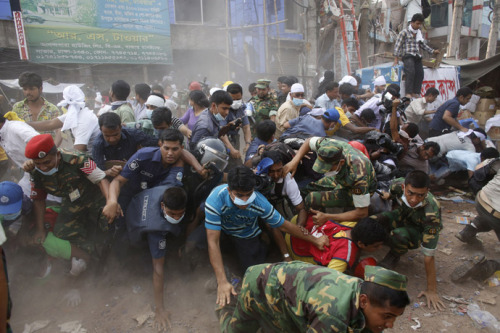 "Police fire tear gas at Bangladeshis protesting factory collapseApril 26, 2013 Bangladeshi police fired tear gas and rubber bullets to disperse a crowd of enraged workers protesting the deaths over 300 of their coworkers in a Wednesday garment factory collapse. At least 25 people have been injured in the clashes. The demonstrators – some armed with bamboo sticks – blockaded roads, smashed vehicles, burned tires and attacked factories at Gazipur, just outside the Bangladeshi capital Dhaka. ""The situation is very volatile. Hundreds of thousands of workers have joined the protests. We fired rubber bullets and tear gas to disperse them,"" M. Asaduzzaman, an officer in the police control room, told AFP. The rioting also spread to several districts in the capital, local media reported. The protesters have demanded the arrest and execution of those responsible for the disaster, and blamed the building's owners for the deaths. The collapsed eight-story building at Savar, a town on the outskirts of Dhaka, housed five factories. Rescuers have recovered nearly 300 bodies form the rubble, and found 62 people buried alive in the ruins; the death toll may rise further. There are fears that hundreds of people remain trapped in the wreckage of the building, which officials claim was built illegally and without proper building permits.""Some people are still alive under the rubble and we are hoping to rescue them,"" Reuters cited deputy fire services director Mizanur Rahman. The building reportedly developed cracks on Tuesday evening, but the owners ordered fleeing workers to return to their production lines, survivors said. The incident was the worst to befall Bangladesh since a fire in November 2012 that killed over 100 workers. Many of the country's 4,500 factories have already been closed due to protests and fears of damage. Manufacturers have declared Saturday to be a holiday, while trade unions called for a strike on Sunday to demand better working conditions, AP reported. Special prayers for the dead, injured and missing were offered at mosques, temples and pagodas across Bangladesh on Friday. Source"