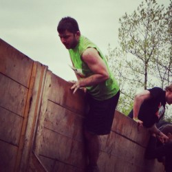Here's me going over one of the many obstacles at Tough Mudder yesterday.
