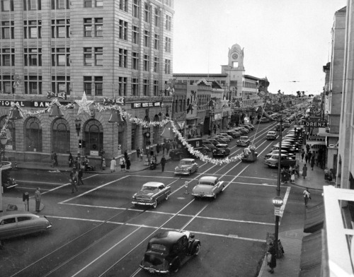 Santa Ana's downtown streets decorated for the holidays in 1945.  Part of the Title Insurance and Trust, and C.C. Pierce Photography Collection in the USC Digital Library.