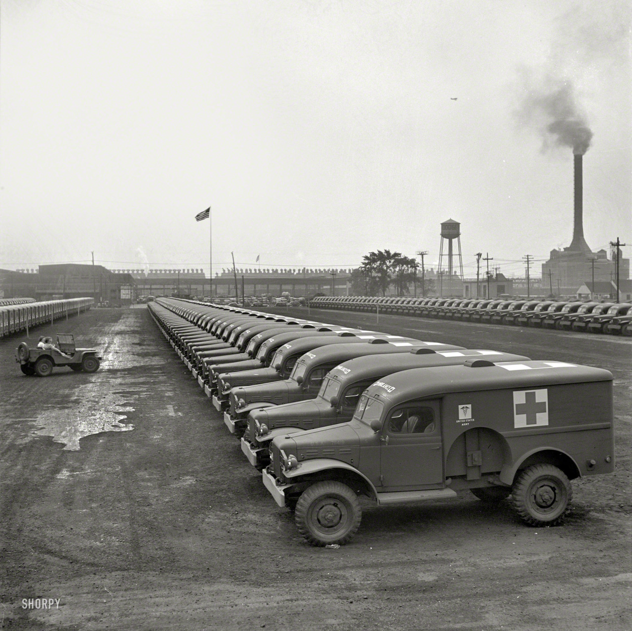 "August 1942. ""Detroit, Michigan. Chrysler Corporation Dodge truck plant. Dodge ambulances are here, lined up for delivery to the Army.""  Photo by Arthur Siegel for the Office of War Information."