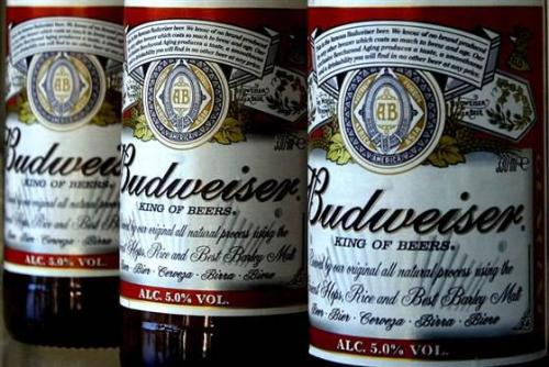 shortformblog:  nbcnews:  Budweiser sued for watering down beer  (Photo: Kirsty Wigglesworth / AP) Beer lovers across the country have filed $5 million class-action lawsuits accusing Anheuser-Busch of watering down its Budweiser, Michelob and other brands. Read the complete story.  This lawsuit could have been filed anytime in the last 50 years. (Seriously, though, Bloomberg Businessweek had a killer cover story on this very topic not so long ago.)