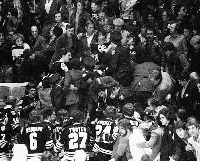 Mike Milbury and his Bruins teammates invade the stands at Madison Square Garden during a 1979 game against the Rangers. Though chances are slim fans will see a brawl like this, SI's Stu Hackel expects more violence in a shortened season. (Bruce Bennett/Getty Images) HACKEL: Five things to watch in a 48-game season
