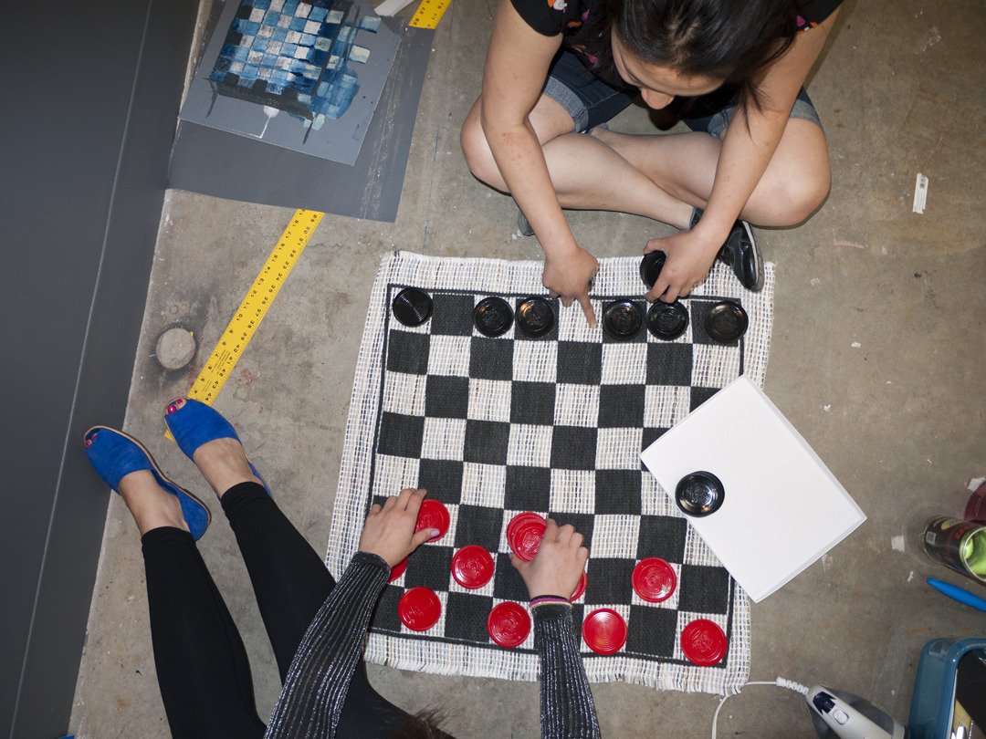 Darja and Tammy playing checkers in Darja's studio