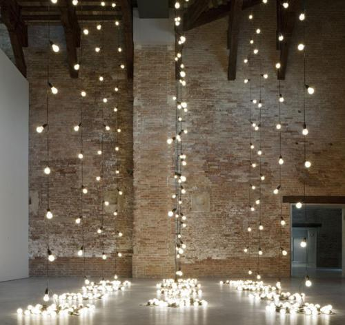 Piles of light reach up to the ceiling.