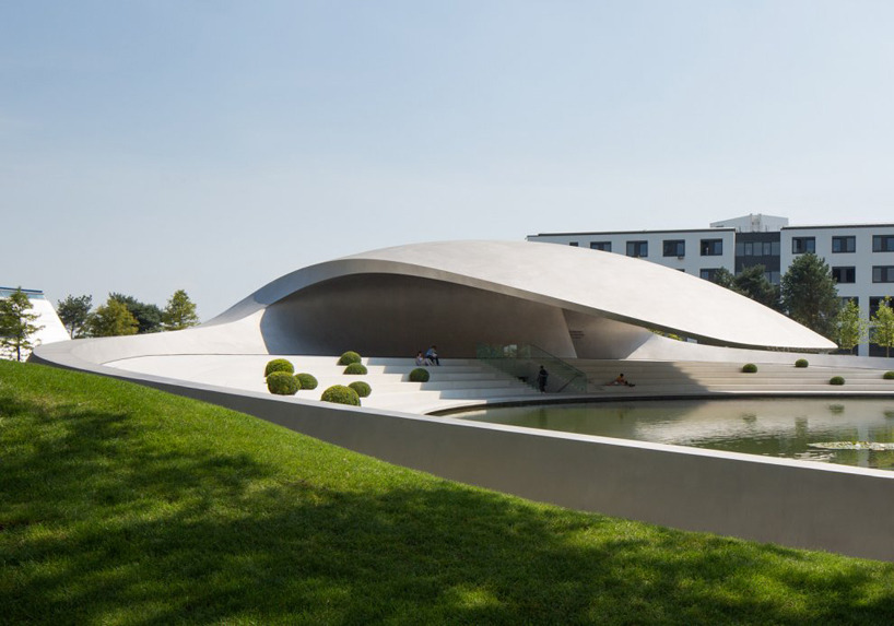 squeedesign:  Porsche Pavilion  The new Porsche pavilion at the Autostadt in Wolfsburg, Germany is the first addition to the theme park since its 2000 opening. Designed by german firm henn architekten, the curved lines and form are derived from the 'dynamic flow of driving', encompassing the universal image of the Porsche brand. Squee: facebook|twitter|signup|