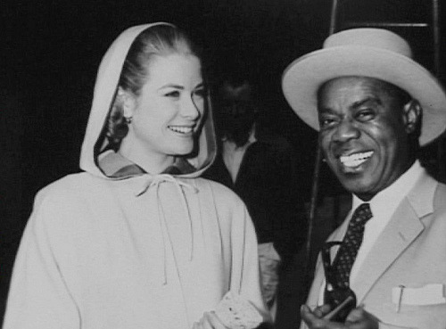 Grace Kelly with Louis Armstrong on the set of 'high society'