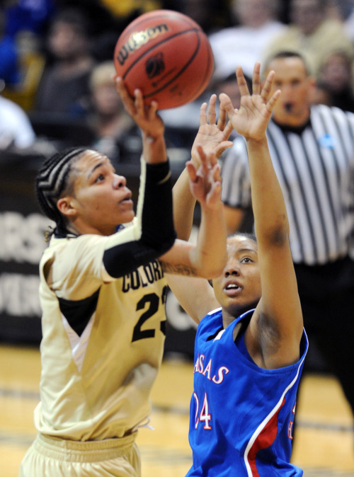 "Moving On In the second round of the WNBA Draft, CU Buffs' Chucky Jeffery was selected by the Minnesota Lynx on Monday. A dream for Jeffery, the former Buff is excited to ""have a team."" Read the full story here. Above, Chucky Jeffery shoots over Charicia Harper of KU on March 23. (Cliff Grassmick)"