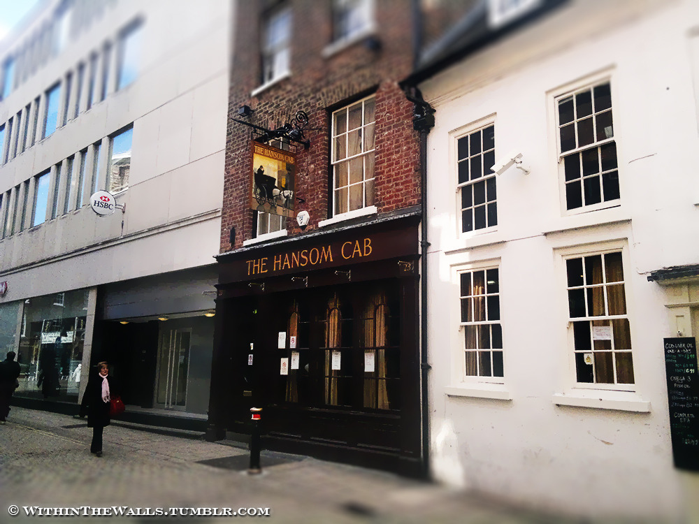 Review - The Hansom Cab **** New review now online, here's the summary: Named after the famous York architect Joseph Hansom who designed and patented the Hansom Cab in 1834, this Sam Smith's pub is a real surprise. From the exterior it may come across as a bit of an intimidating small pub especially with its odd location down one of the central side streets, but upon entering you are greeted with a beautifully classic Victorian style decor. Dark oak panels, green leather chairs, gleaming brass and frosty etched glasswork in a very spacious area. The clientele is deceptive too, this is not just the haunt of the grumpy old man there's a wide range of people enjoying the good range of Sam's beers at the cheapest prices you'll find anywhere in York, other than another Sam's pub that is. Obviously this is strictly a real ale style pub, no music or entertainment and definitely no kids, their focus is a friendly local pub that serves lots of quality cheap beer in a relaxed environment. There's no outside area and the toilets would only really be classed as functional but the Hansom Cab is a welcome change from similar pubs which are usually grubby and uninviting, which is why even though scoring zero in several categories we are still awarding it a 4/5, we'll definitely be back. For further details and full scores see the main page.