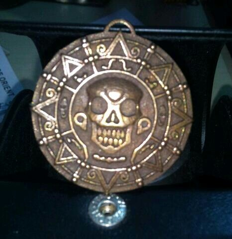 NEW Pirates Of The Caribbean Cursed Aztec Gold Necklace Pendant! 'Ello poppet! Get your very own piece of Aztec gold from the treasure of the Isla de Muerta to hang around your neck, on your car mirror, or just hide it away in your treasure chest. Perfect for Elizabeth Swann cosplay/Halloween costume. May or may not turn you into a living dead skeleton. Warning: Stay out of the moonlight. Follow MNM on Tumblr and or Facebook (10% off code)