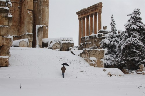 Powerful winter storm brings snow, havoc to Mideast AP:   The fiercest winter storm to hit the Mideast in years brought a rare foot of snow to Jordan on Wednesday, caused fatal accidents in Lebanon and the West Bank, and disrupted traffic on the Suez Canal in Egypt. At least eight people died across the region.   Photo: A visitor climbs the steps of Baalbek's Bachus temple as snow covers the Roman ruins of the historic town in eastern Lebanon's Bekaa Valley on Jan. 9, following a fierce storm that has whipped the region this week with temperatures dropping and snow falling across Lebanon, Syria, Jordan and Israel. (AFP - Getty Images)