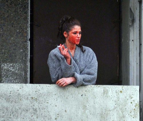 Actress Gemma Arterton on a break during the filming of 'Byzantium'. She went out to the balcony for a smoke and forgot to clean the fake blood off her face.