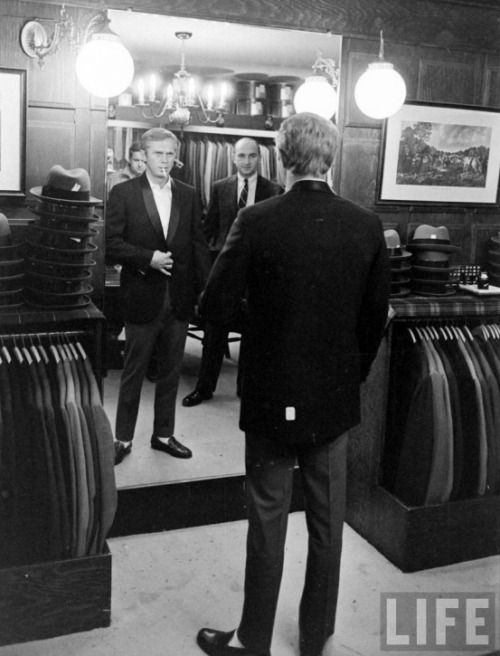 Steve McQueen getting fitted for a tux.