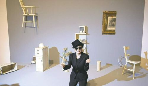 Yoko Ono poses in front of her installation HALF-A-ROOM (1967) in Frankfurt in February
