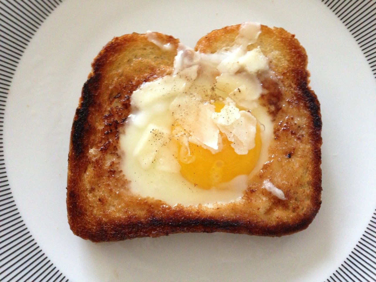 Toad in the hole (egg in the basket) with a sprinkling of grated pecorino romano, courtesy of moi! It was quite tasty, if I may say so myself. -Gastrodamus
