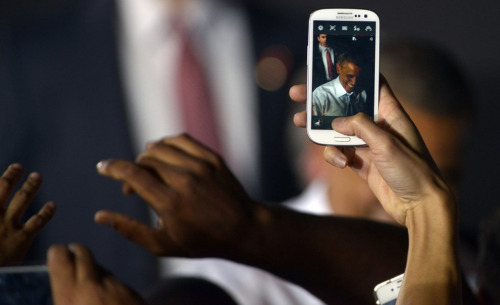 Obama, on smartphone. View this year's best work by Washington Post photographers and videographers. Photo by Marvin Joseph (The Washington Post)
