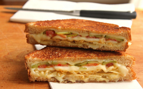 deliciousbites:  Grilled cheese with tomato, pickles, and potato chips.