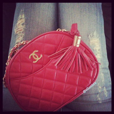 Today's accessory: Touch of red paired with distressed skinny jeans.