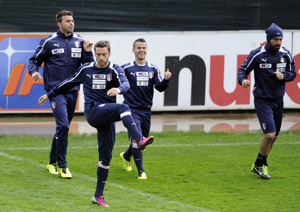 Claudio Marchisio, Andrea Barzagli, Sebastian Giovinco frolic at Coverciano whilst Andrea Pirlo takes his training seriously …  … until the boys are apparently interrupted for a photo op. It seems they didn't take too kindly to the interruption … that's some serious bitchface being thrown in the camera's general direction right there.