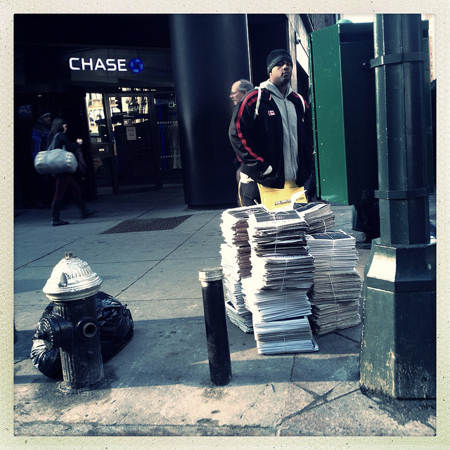 newspaper vendor. on Flickr.Newspaper vendor on 42nd Street across from Grand Central.