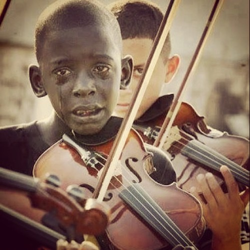 thepoetproject:  Brazilian boy Diego Frazao Torquato playing at the funeral of his murdered violin teacher, Evando Joao da Silva. Diego will die a year later in a failed surgery related to his leukemia. Do yourself a favour & live the moments you have. F*ck the petty problems & create the existence you. A healthy existence is a luxury so few are afforded, find/create reasons to cherish it.