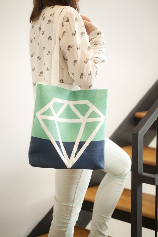 Customize your own tote with a geometric gem design using fabric paint. (via Whimseybox)