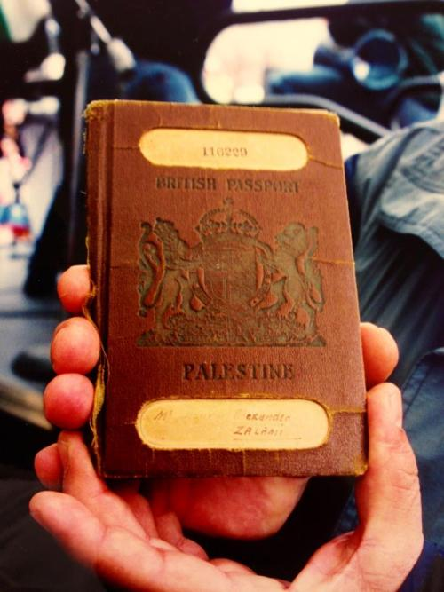 Palestinian man shows family passport under British Occupation of Palestine during Al-Awda's Historic Right of Return Rally on April 7, 2001 at Union Square, New York. To All of you Zionists who claim that there was never anything called Palestine.