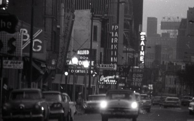 Looking south on Rush from Delaware, 1957, Chicago.