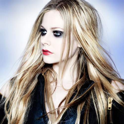 "Avril Lavigne tells Billboard that her upcoming album, which will include pop-rock tunes, piano ballads and a Marilyn Manson collaboration, is ""all over the place."" Read our new interview with the 28-year-old singer-songwriter. (Photo by Mark Liddell)"