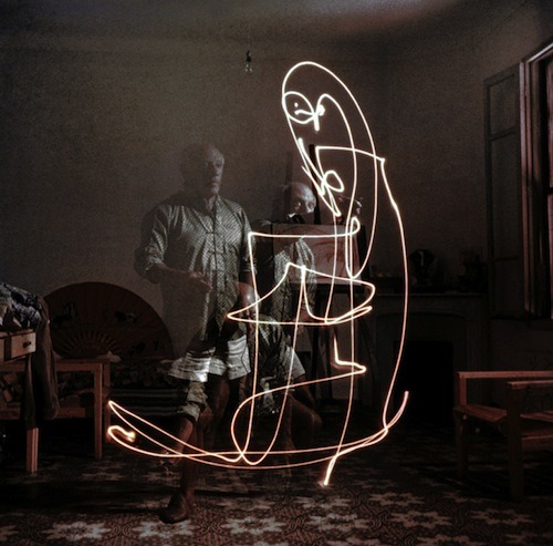 wellwornwornwell:  Pablo Picasso making light drawings, 1949